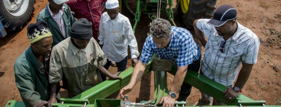 African farmers and Dutch entrepeneur viewing agricultural machine