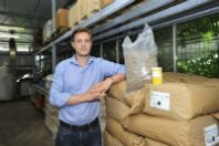 Man leaning on bags with fishmeal