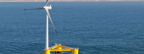 Floating wind turbine in water